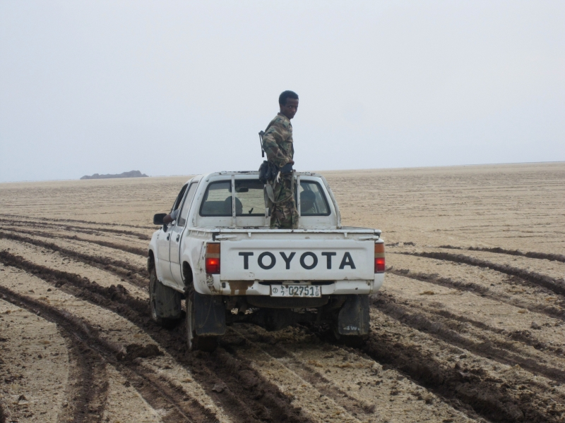 Ethiopian soldiers protecting us on the trip to acid lakes and our 'reserve' vehicle