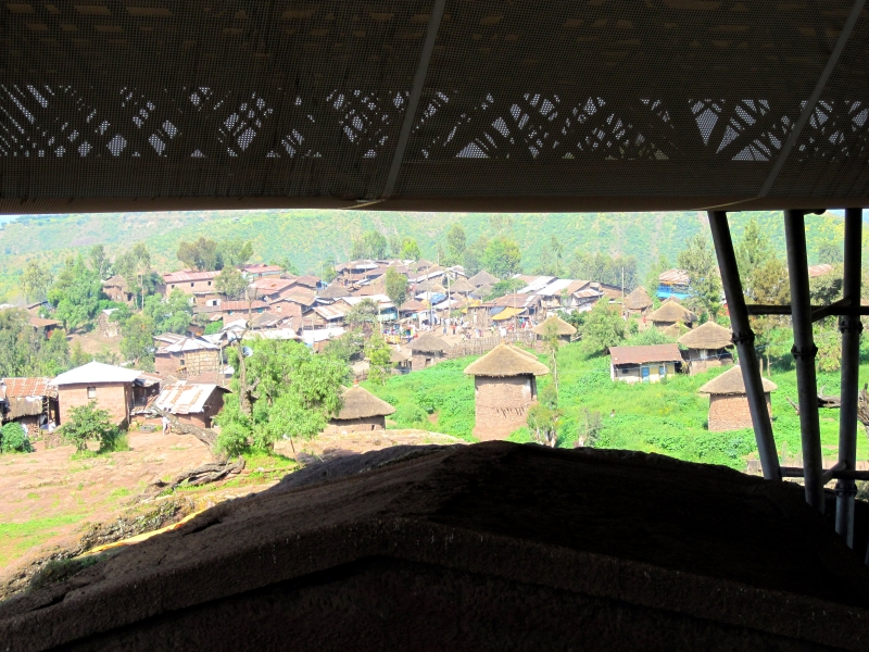 Traditional two-story round houses dominate the center of the mountainous site in Lalibela