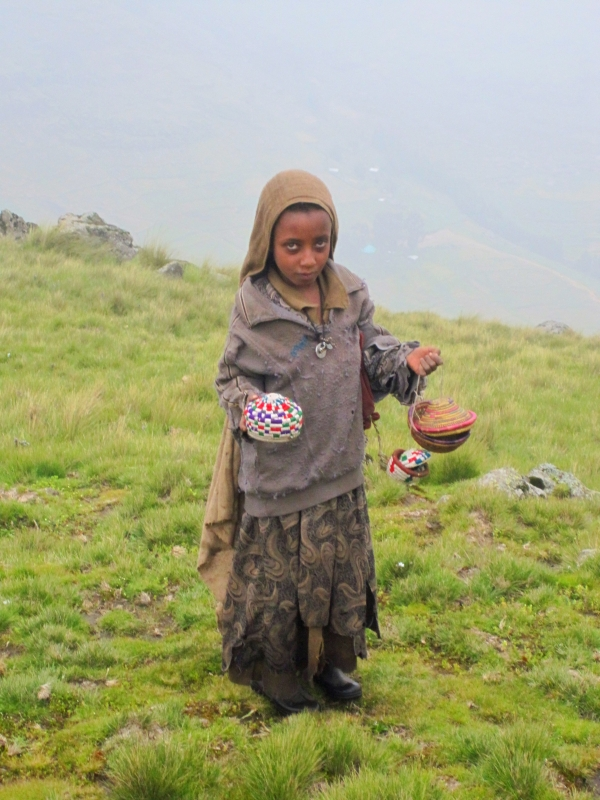 Shepperd girl selling souvenirs in the altitude of  4000 m (Semien mountains)